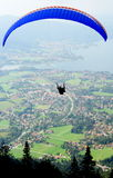 Parachuting. A parachuter is taking off from Wallenberg, high above Tegernsee. Lake Tegern (Tegernsee), Bavaria, from Wallenberg with Rottach-Egern and the town Royalty Free Stock Photography