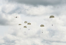 Parachuting or skydiving. Skydivers jump from an airplane with parachute Stock Photo