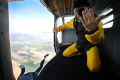 Parachuting on sunny day. Parachutist in the airplane before jump on sunny day Royalty Free Stock Photos