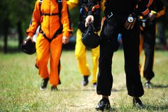 Parachuting on sunny day. Parachutists fully equipped on the way to airplane Royalty Free Stock Photos