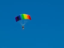Parachutist. Colorful parachute against blue sky Stock Photo