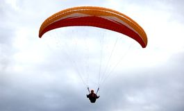 Parachutist. In blue sky Royalty Free Stock Photo