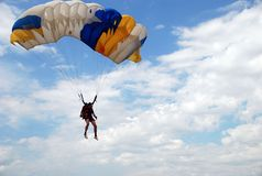 Parachutist. A landing of parachutist with clouds Royalty Free Stock Photo