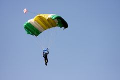 Parachutist. With open parachute in the sky Royalty Free Stock Images
