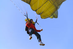 Parachutist. Pulling brakes of a green parachute Royalty Free Stock Photo