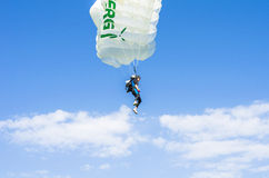 Parachutist in the air. Female parachute jumper up in the sky participating at the Red Bull Ordinul Smaranda competition on June 7, 2014 in Bucharest, Romania Stock Photos