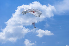 Parachutist in the air stock images