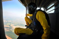 Parachuting on sunny day. Parachutist in the airplane before jump on sunny day Stock Photography