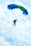 Parachutist in the blue sky Stock Images