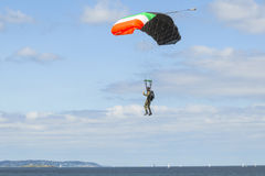 Parachutist in the blue sky Stock Photo