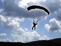 Parachutist on a cloudy sky Stock Photos