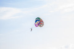 Parachutist flying on multi-colored parachute Royalty Free Stock Photography