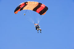 Parachutist jumping on a background of blue sky Royalty Free Stock Image