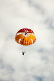 Parachutist landed on a background of the cloudy sky. Royalty Free Stock Photos