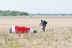 Parachutist landed, folding the parachute Royalty Free Stock Photography