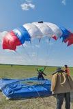 Parachutist landed near a target Stock Photos