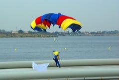 Parachutist landing on lake Stock Photo