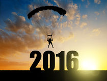 Parachutist landing in the New Year 2016. Silhouette skydiver parachutist landing in the New Year 2016 Royalty Free Stock Images