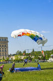 Parachutist landing. Parachute jumper landing feet first on air bed at the Red Bull Ordinul Smaranda competition on June 7, 2014 in Bucharest, Romania Royalty Free Stock Photos