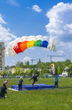 Parachutist landing. Parachute jumper landing with one foot stretched at the Red Bull Ordinul Smaranda competition on June 7, 2014 in Bucharest, Romania Stock Photo