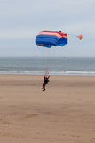 Parachutist Landing Stock Images
