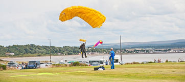 Parachutist landing on target at Fort George Stock Image