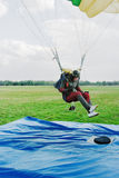 The parachutist lands on a floor-mat with a target Royalty Free Stock Images