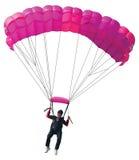 Parachutist met roze valscherm Stock Afbeeldingen