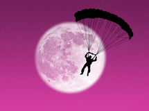 Parachutist in the moon Royalty Free Stock Photos