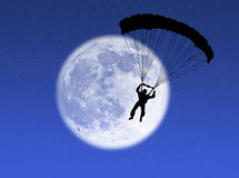 Parachutist in the moon Royalty Free Stock Photography