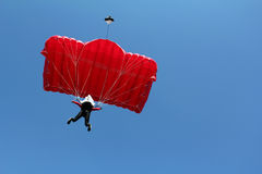 Parachutist with red parachute Stock Photography