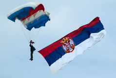 Parachutist with Serbian flag Stock Images