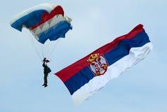 Parachutist with Serbian flag. BELGRADE - SEPTEMBER 13: BATAJNICA 2009 INTERNATIONAL AIR SHOW Stock Images