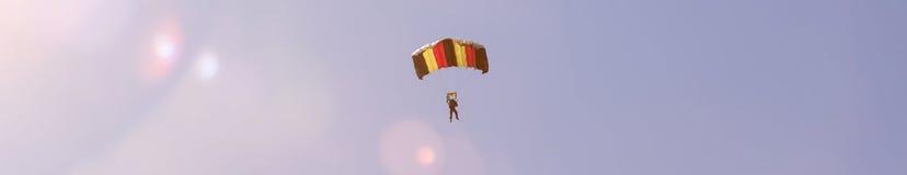 Parachutist in a summer sky Stock Image