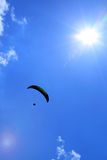 Parachutist and sun flares Stock Images