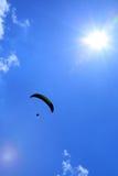 Parachutist and sun flares stock images