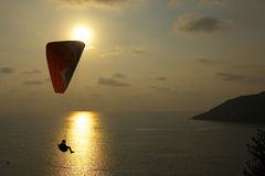 Parachutist at sunset Stock Photos