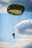 Parachutist in the war. Military parachutist in the war cloudy sky Royalty Free Stock Photos
