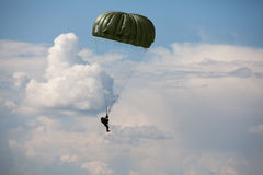 Parachutist in the war. Military parachutist in the war cloudy sky Stock Images