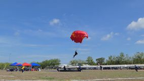 Parachutist was landing in to the target, Accuracy Landing,. In during Thai Army Parachuting Competition 2019 on June 15, 2019 in Lopburi , Thailand stock video