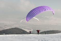 Parachutists. O the snow land Stock Image