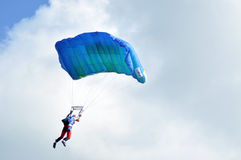 Parachutists flying in the air Stock Images