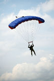 Parachutists jumping athletes. Demonstration parachutists jumping athletes. In flight, the operator of the camera to his helmet. In the sky over Moscow Stock Photography