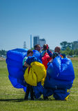 Parachutists saluting after they jumped Royalty Free Stock Photo