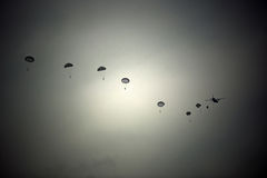 Parachutists. Skydivers jump from a plane Stock Photo