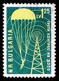 Parachutists and Transmission Tower, Congress of the Aid Organization DOSO serie, circa 1959. MOSCOW, RUSSIA - SEPTEMBER 15, 2018: A stamp printed in Bulgaria stock photos