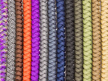 Paracord background 03. Background of severals tied knot bracelets Royalty Free Stock Photography