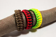 Paracord bracelet 09. Paracord bracelets on wooden branch Royalty Free Stock Photos
