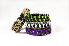 Paracord bracelets stacked. Paracord bracelet stacked on eachother, with luxury clip Royalty Free Stock Image