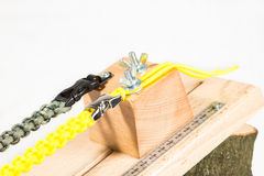 Paracord knotting board Pro. Paracord knotting board to make the tying of a paracord bracelet much easier Stock Photos